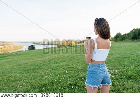 Breakfast In Nature, Girl Stands In Park Summer, Looks River, Free Space For Text, Woman Holds Cup C