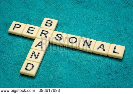 personal brand crossword in ivory letter tiles against textured handmade paper, identity and style concept