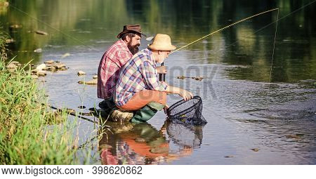 Bait And Hook. Hobby And Recreation. Good Catch. Bearded Men Fishing. Family Day. Lucky And Skilled.