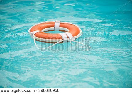Life Buoy. Lifebuoy In Water. Life Ring Floating In A Sea, Life Preserver. Rescue Ring. Rescuering,