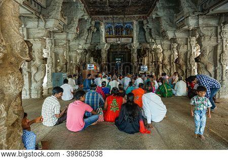 Hampi, Karnataka, India - November 4, 2013: Virupaksha Temple Complex. Devotees Gather Sitting In Ma