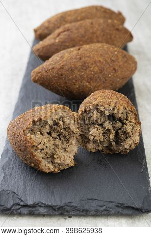 Traditional Arabic Fried Kibbeh Over Stone Board. Typical Brazilian Snack.
