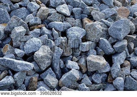 A Pile Of Stones In A Landfill For Use On A Construction Site Or In Garden Architecture For Mulching
