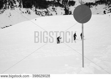 Marker On Off-piste Snowy Slope For Freeriding In High Winter Mountains. Ski Area Mottolino, Italian