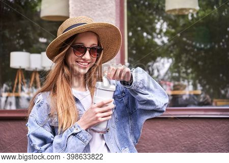 Pretty Girl With Eco Coffee Cup. Drinking Beverage Outdoors. Reusable Lifestyle. Staycation Concept.
