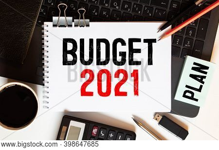 Finance, Business And Economy Concept - 2021 Budget Text Written On Notepad. Stock Photo