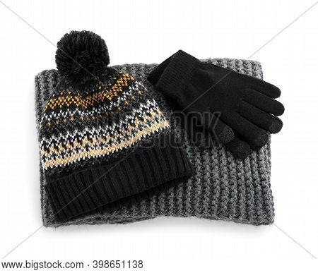 Woolen Gloves, Scarf And Hat On White Background, Above View