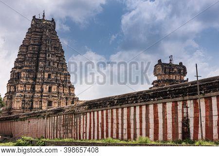 Hampi, Karnataka, India - November 4, 2013: Virupaksha Temple Complex. Red And White Wall Around Sai