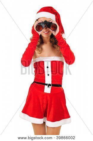 Isolated young christmas woman with binocular