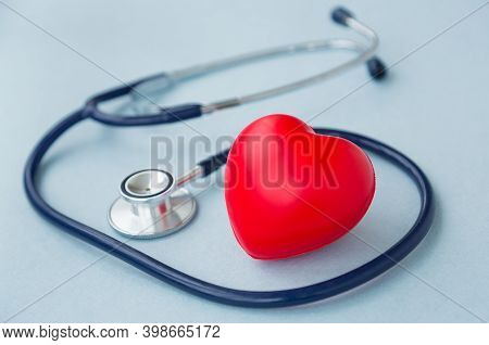 Red Heart With Heartbeat Or Heart Rate And Stethoscope On Blue Background. Medical And Health Care,