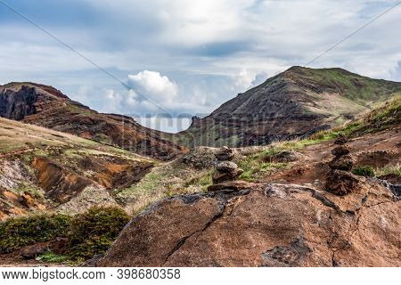 Rock Tower In Front Of Rocky Cliffs At Ponta De Sao Lourenco, The Island Of Madeira, Portugal