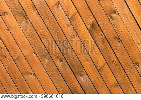 The Background Is Made Of Wooden Pine Boards With A Sloping Diagonal Arrangement. Tinted Wood Textur