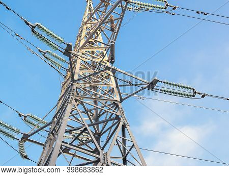 Electric Support, Illuminated By The Bright Sun. Power Transmission Tower Against The Sky. Electric