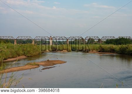 Kruger National Park, South Africa April 20 2016: Old Historic Train Bridge Over The Sabie River At