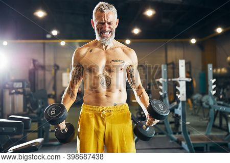 Energetic Trainer Doing A Strength Training Exercise