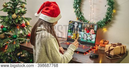 Woman With A Glass Of Champagne Is Remotely Communicating With Friends Or Family Via Video Link. Con