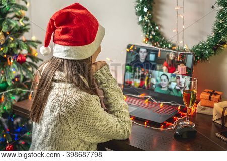 Woman At Home Is Communicating Remotely With Her Friends And Congratulates Them. Concept Of Holiday