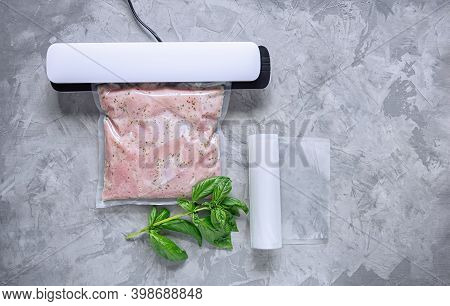 Marinating Meat Using Technology Sous Vide In A Vacuum Bag. Bbq Meat.