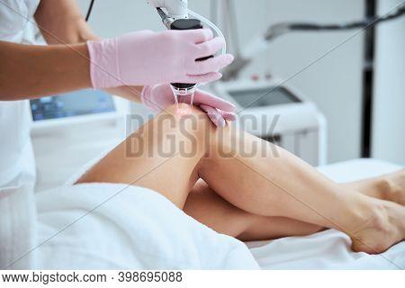 Female Client Undergoing The Laser Vein Treatment