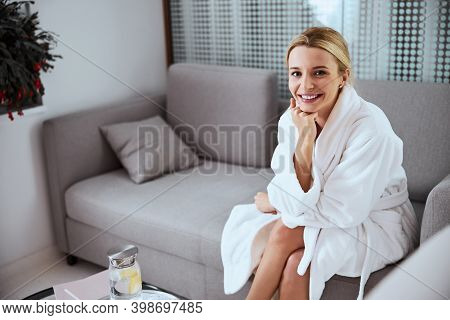 Joyful Attractive Patient Sitting On The Sofa In The Foyer