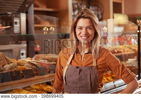 Lovely Mature Small Business Owner Smiling To The Camera At Her Bakery Store, Copy Space