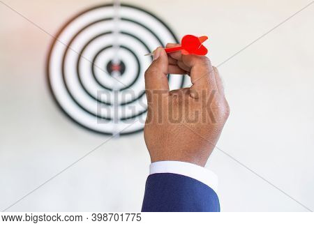Red Darts In The Hands Of The Businessperson Prepare To Aim At The Concept Of Aiming, Targeting, Tar