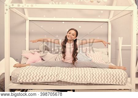 Adorable Gymnast. Happy Child Sit In Split Position. Little Girl Do Split In Bed. Cross Split. Stret