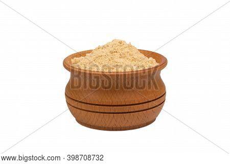 Bio Organic Dried Ginger Powder In Wooden Bowl