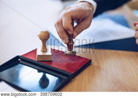 Man Lawyer Holding Notary Public Ink Stamper