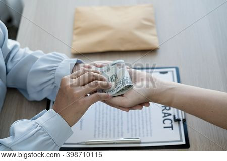 The Owner's Business Offers And Gives Money To His Partners For Bribery And Corruption. The Concept