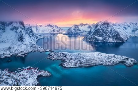 Aerial View Of Reine At Sunset In Winter. Top View Of Lofoten Islands, Norway. Landscape With Blue S