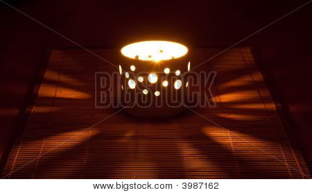 Candle On The Straw Napkin
