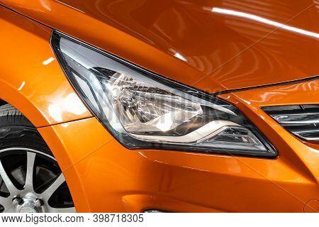 Novosibirsk, Russia - December 07, 2020: Hyundai Solaris , View Of The Front  Of The Car. Orange Car