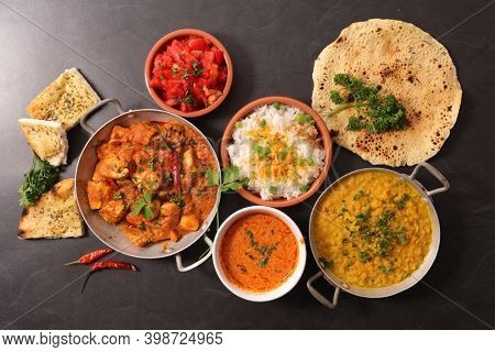 assorted of indian dish with curry dish, naan,  chicken