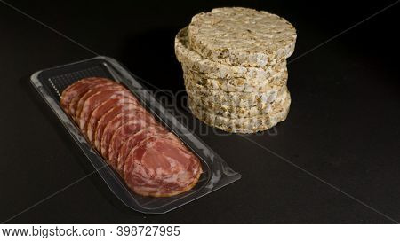 Grain Crispbreads Crispy Rice And Diet Bread With Smoked Sausage. Rice Cake Puffed Rice With Salami,