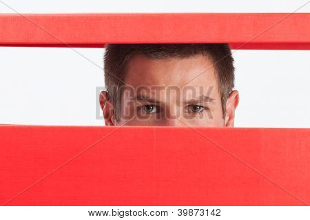 Concerned young man stuck in red box