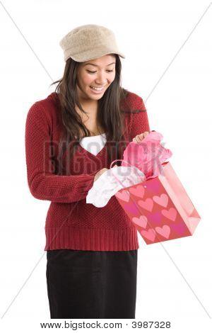 Asian Girl Opening Valentine Gift