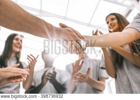 Close Up. The Delegates Of The Youth Meeting, Shaking Hands With Each Other.