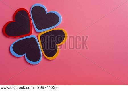 Four Hearts On A Pink Background. Concept Of Valentine's Day And Mother's Day.