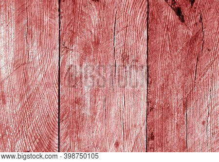 Wall Made Of Uncutted Weathered Wood Boards In Red Tone. Abstract Architectural Background And Textu