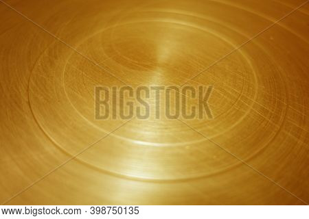 Scratched Round Metal Surface. Background And Texture For Design. Blur Effect