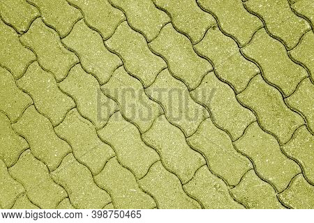 Stone Pavement Surface In Yellow Tone. Abstract Background And Texture For Design.