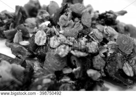Tasty Granola On White With Blur Effect In Black And White. Food And Ingredients Background.