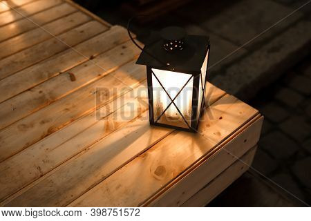 Christmas Lantern On The Wooden Table. New Year And Christmas Decorations
