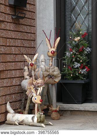 Wood Deer Near The Door As Christmas Decoration