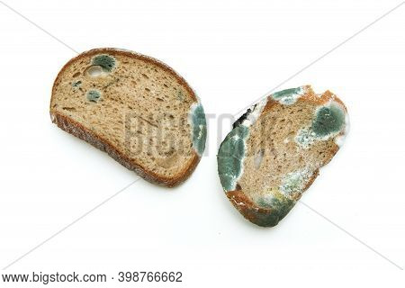 The Picture Of A Mouldy Bread. Rotten And Uneatable. Isolated On White Background.