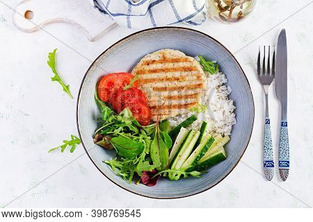 Chicken Schnitzel Or Cutlet, Poultry Meat Grilled And Boiled White Rice With Fresh Salad. Healthy Di