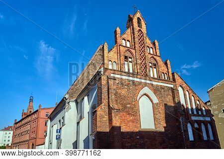 A Medieval Catholic Church And Historic Tenement Houses In Poznan