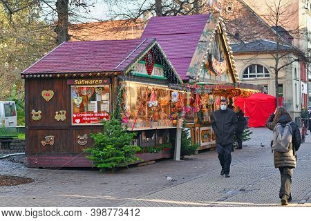 Heidelberg, Germany - December 2020: Festive Decorated Christmas Market Sales Booth Selling Food And