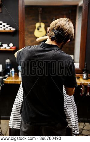 Barber Cuts A Client In A Stylish Barbershop. Men's Haircut With A Razor. Electric Machine. Haircut